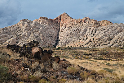 Highly fractured Navajo Sandstone - Snow Canyon - Utah Tertiary basalt flow fills the foreground valley