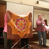 John Putnam showing us his Lonestar quilt that began in the class taught by Jan Krentz