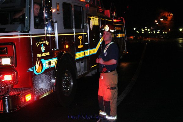 Louisville fire department investigates the fire alarm at the Executive West