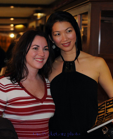 Jeanette Lee poses with a fan