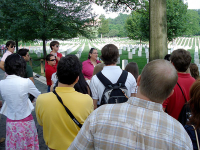 Group listening to guide Ellen Gold during a tour of Arlington Cemetery.