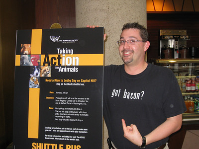 Scuba appreciates the juxtaposition of a funny T-shirt and the animal-rights convention sign in the hotel.