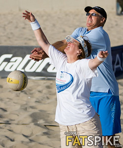 Sinjin Smith and a Special Olympian go for the ball