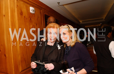 Buffy Cafritz and Debbie Dingell keep an eye on arrivals while sharing a word.  Buffy and Bill Cafritz host a party marking the opening of the newly refurbished Jockey Club in the Fairfax Hotel in Washington, DC on Thursday, November 20, 2008.  (James R. Brantley)