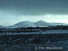 Snow covered mountains viewed from the train near Freemount between Rathmore and Killarney. Fri 01.02.08