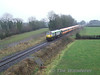 216 passes Shanderry, outside Portarlington with the 1435 Heuston - Galway, 5 Mk3 P/P. Sat 19.01.08