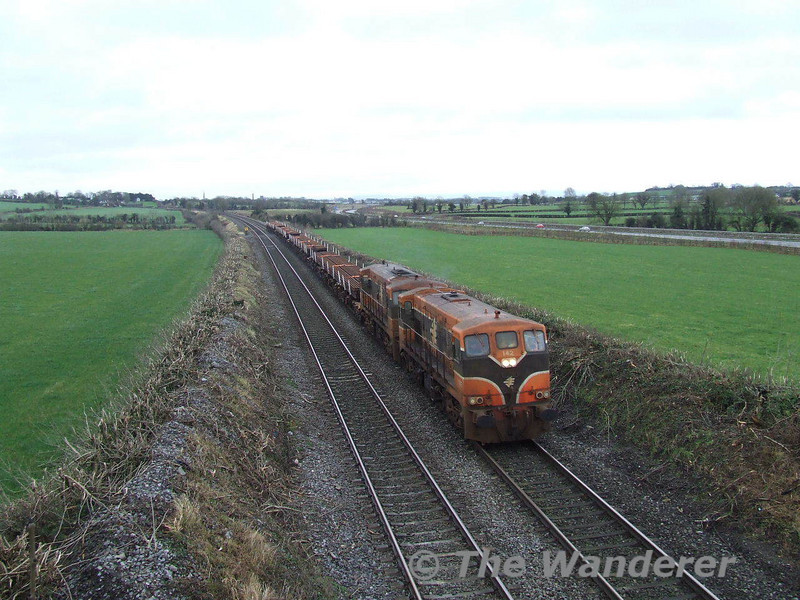 """142 + 149 pass Cherryville Junction with a Waterford - Portlaoise Per Way Depot """"Rail Train"""". These rails were delivered in through Belview Port and loaded onto the train on Saturday. Sun 20.01.08"""