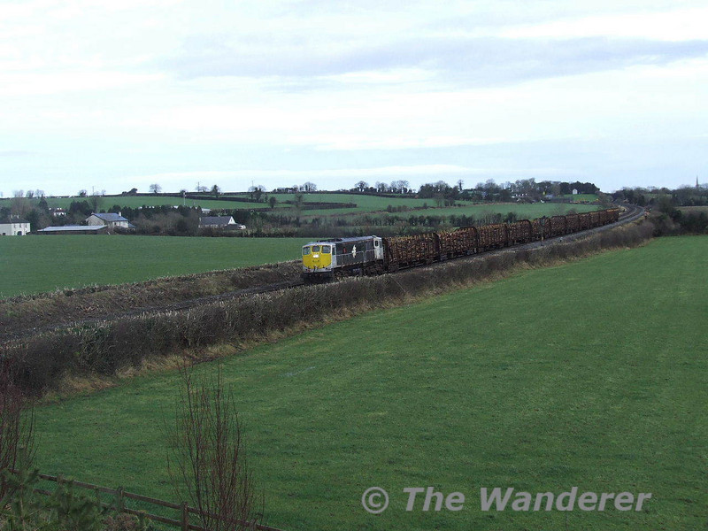 075 rolls towards Cherryville Jct with the 1210 North Wall - Waterford laden Timber. Sun 13.01.08