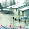 Citizen photo by Brent Braaten A house along Pulpmill Road surrounded by water Monday morning.
