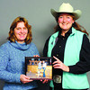 Citizen photo by David Mah Patty Gerhardi, British Columbia Rodeo Association Marketing Manager, left, thanks Trina Wong of Katan Contracting-Klassic Autobody for donating $2000.00 to the BCRA in sponsorship of prizes.