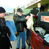 Citizen photo by Brent Braaten Butch Hopp centre hands out warm cloths to Art Gillmor in front of the St. Vincent de Paul Society on Second Avenue. Hopp is a recovering alcoholic and this is his way of giving back.