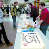 Citizen photo by Brent Braaten Valentine Crawford, right, and Wayne King, centre, hand out cake in the atrium at CNC to celebrate the 30th Anniversary of CNC Student Union Wednesday.