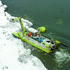 (PG 101) PRINCE GEORGE, January 19--Amphibex-- An amphibious excavator works on the ice jam at the confluence of the Nechako River and Fraser River Saturday afternoon in Prince George. The machine, an Amphibex that has been brought in from Montreal will be working around the clock for the next 10 days to help clear out the ice jam. (CP PHOTO) 2006 (PRINCE GEORGE CITIZEN--BRENT BRAATEN)