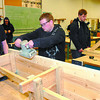 Citizen photo by David Mah PGSS Grade 11 Transitions into Trades students Steven Baker, left, Brian Huedes, Greg Smith, and Brandon Budd work on their pine benches. 12  benches designed by students are being made with wood being donated by Lakeland Mill.