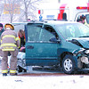 Citizen photo by Brent Braaten City of Prince George Fire Fighters and BC Ambulance paramedics tend to the occupants of a van involved in a crash with a pick-up truck on Victoria Street and 9th Avenue just beefor noon Tuesday .