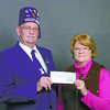 Citizen photo by Brent Braaten Laurie Meier Exalted Ruler Elks Lodge #122 presents a cheque for $3,000 to Joan Beaudoin with Prince George Hospice society. The money was raised through gamming and will go to operating expensises at hospice.