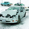 Citizen photo by David Mah A single car sits at the Bypass exit and Massey Drive after crashing on the icy roads Thursday afternoon.