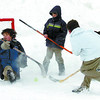 Citizen photo by David Mah Nathan Trudeau, 11, left, Jacob Cundy, 8, shooter Andrew Ardell, 10, Ian Walker, 10, and other Westside Academy students played hockey in the parking lot Tuesday morning.