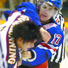 Citizen photo by Brent Braaten Kings Morgan MacLean and Vernon 's Dallas Goodrunning get into a scrap during first period.
