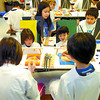 Citizen photo by David Mah Ron Brent Elementary students front row Casey Curry, left,  Jasper Yutuc, back row Christine Contois, left, and Austin Haugen, all 9, paint their self-portraits. Over 120 portraits will be made by intermediate students. The concept came from Betty Kovacic's Highway of Tears exhibit.