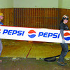 Citizen photo by David Mah Dirk Graham, left, and Amanda Woodland of IDL Projects remove the Pepsi sign from the old UNBC Fitness Centre in preparation for the new Northern University Student Centre. The 20,000 square foot, $2.4 million renovation will open in September 2008.