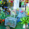 Citizen photo by Brent Braaten Katie Zammit , manager of Ginger Bread Toys in College Heights has some fun with the dinasour display in the front window of the store. Zammit and other staff members put the diaply together on Monday.