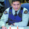 Citizen photo by David Mah RCMP Const. Jose Rangel Perez with two tylenol containers with 16 and 17 Ecstasy pills.