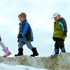 Citizen photo by David Mah Nadine Finch, 6, left, Zachary Hoskins, 6, his brother Jacob, 3, and Nadine's sister Claire, 3, walked on their Mount Everest on a snow hill in the parking lot by the Prince George Gymnastics Club.