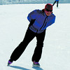 Citizen photo by Brent Braaten Cheryl Holmgren and her mom Joanne cook, behind,  get some skating in on the Outdoor Ice Oval Thursday afternoon. Despite the warm daytime temprutures the ice is holding up well.