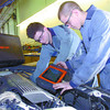 Citizen photo by Brent Braaten Mark Wetland, left and Dean Lewis, both first year CNC automotive students work on a special car built by Benchmark Automotive that simulates problems that the students have to diagnose and fix.