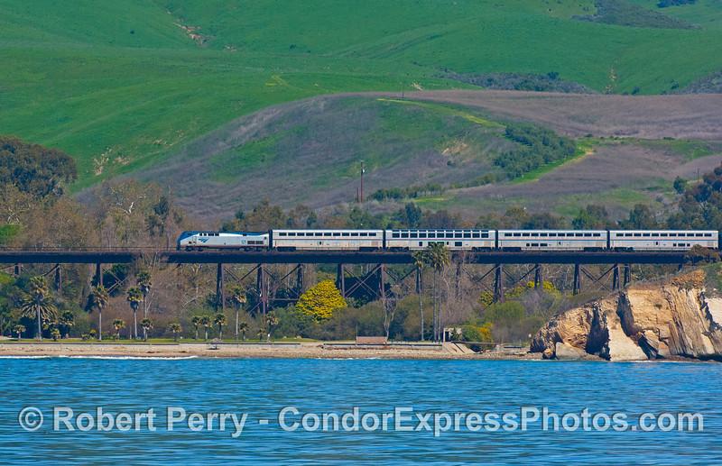 Amtrak train on bridge from water 2008 03-10 Sta Barbara -- 252