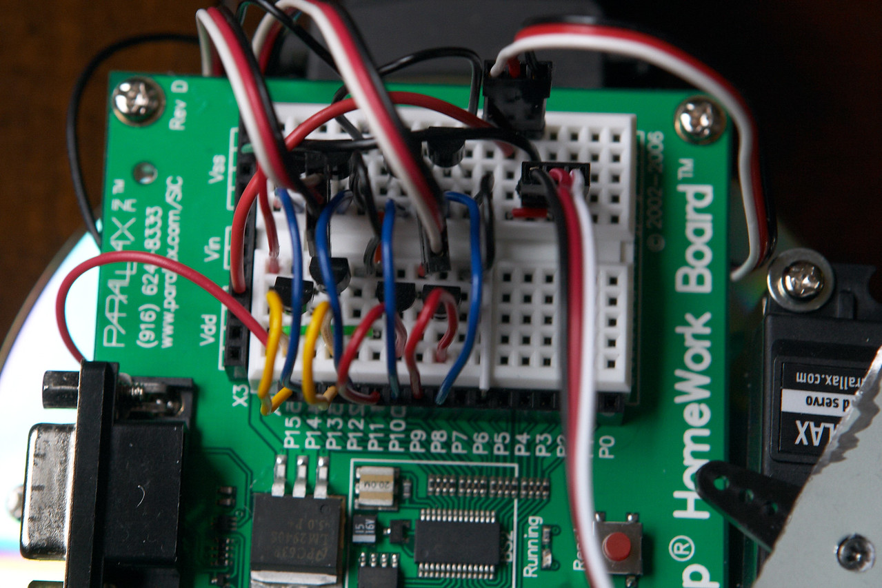 The majority of the breadboard is taken up by just the two H-bridges (4 transistors each) for controlling the two motors. Aside from that, pin 6 controls the servo to position the sonar, and pin 2 interfaces with the sonar itself