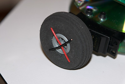 That's one way to attach a foam model airplane tire to a servo control horn