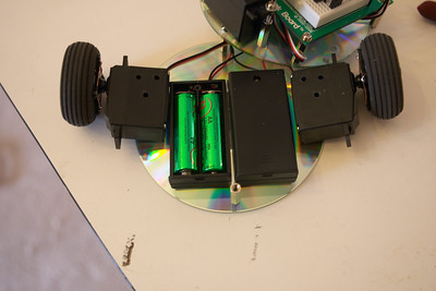 Harry disassembled. The 4 rechargeable AAs provide (4 x 1.2v) 4.8v for the motors, while the sonar and microprocessor are powered by the 9V battery on the top level