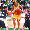 Citizen photo by David Mah UNBC Timberwolf Chelsea McMullen breaks through Okanagan Lakers Mandy Trenholm, left, and Melissa Irish Friday in the Provincial Basketball Championships Friday at the Charles Jago Northern Sport Centre at the University of Northern British Columbia in Prince George.