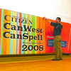 Citizen photo by David Mah Colleen Sparrow, left, and Allan Ramsay from the Citizen, Glen Haley, Vanier Hall stage manager, and Judie Dahl with the CanWest CanSpell team hang the banner in preparation for the 2008 Spelling Bee at Vanier Hall.