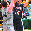 Citizen photo by David Mah Douglas College Royal Shane Heuring, left, blocks Okanagan Laker Matt Gowing in the Provincial Championship.