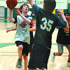 Citizen photo by David Mah Matthew Montgomery, 12, of the Sharks, tries a shot against Brian Heywood, 13, of the Warriors during the year-end play day of the Prince George Minor Basketball League. 370 players took part Sunday at the Charles Jago Northern Sport Centre.