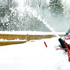 Citizen photo by Brent Braaten Cassidy Dahl uses a snowblower to clear a driveway on Vallencher Road Monday morning.