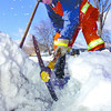 Citizen photo by Brent Braaten Kerry Gobbi with City of Prince George Utilities Department works at making a channel for water to flow into a storm drain at the corner of 15th Avenue and dogwood Tuesday afternoon. With the record snowfall and Tuesday warm tempatures made city crews busy looking for storm drains barried in ice.