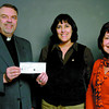 Citizen photo by Brent Braaten Pastor Roland Ziprick of Our Saviours Luthern Church presents a $5,000 donation to Tarra Mason Ward and Karen Miller of the Canadian Red Cross. This donation was raised through the Evangelical Luthern Church in Canada's 'Global Hunger and Development Appeal' fund, for Prince George residents affected by the Nechako River flooding.