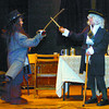 Citizen photo by David Mah Kalyn Brown, 12, left, playing Pew, and Karl Ewert, 9, playing Billy Bones have a duel in the openng scene of the musical adaptation of Treasure Island put on by the Bel Canto Junior Choir at Spruceland Elementary School Thursday.
