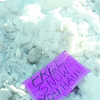 Citizen photo by Brent Braaten A sign spotted on a huge pile of snow in a yard at the corner of Shane Crescent and Goheen Street Wednesday morning.