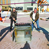 Citizen photo by Brent Braaten MLA Pat Bell, MLA John Rustad, Mayor Colin Kinsley and Councilor Don Zurowski take sledge hammers to an old wood stove. This was to promote the Woodstove Exchange Program at the Burn-it-smart workshop Saturday in the Civic Centre Plaza.