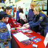 Citizen photo by David Mah Charles Fennell, 10, left, and his mom Jenny, a CNC student speak to Kim Peets and Agnieszka Tokarczuk, both in recruiting for the Canadian Border Services at the CNC-UNBC Job Fair at the CNC atrium Tuesday.