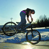 Citizen photo by Brent Braaten Clint Hill,15,  gets some air at the Rotary Skate Park Wednesday evening on his bike. The snow has melted enough in places to use some of the park.