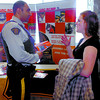 Citizen photo by David Mah Const. Sangha from RCMP E Division Recruiting speaks to UNBC 4th Year International Studies and Political Studies student Kristy Lynch at the 5th Annual CNC/UNBC Job Fair Partnership in the UNBC atrium. Lynch will be joining the RCMP.