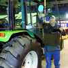 Citizen photo by David Mah Evariste Dubuc from HCM Farm Services in Vanderhoof cleans up a Montana tractor, part of their display in the Prince George Home and Garden Show. The show runs March 14-16 at the CN Centre. Admission is free.