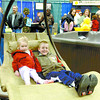 Citizen photo by David Mah Cassidy Taylor, 3, and her brother Michael, 9, found a great rest spot in the Tropical Pool and Spa display Saturday at the Prince George Home and Garden Show at the CN Centre.