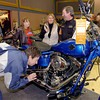 Citizen photo by David Mah Susan Boivin, left, looks closely at the Rocker C Softail engine while Donna Roy, Ragan Bargy, and Harley Davidson Prince George owner Len Hall chat about Harleys at the 4th Annual Motorcycle and ATV Show at the Civic Centre on the weekend.